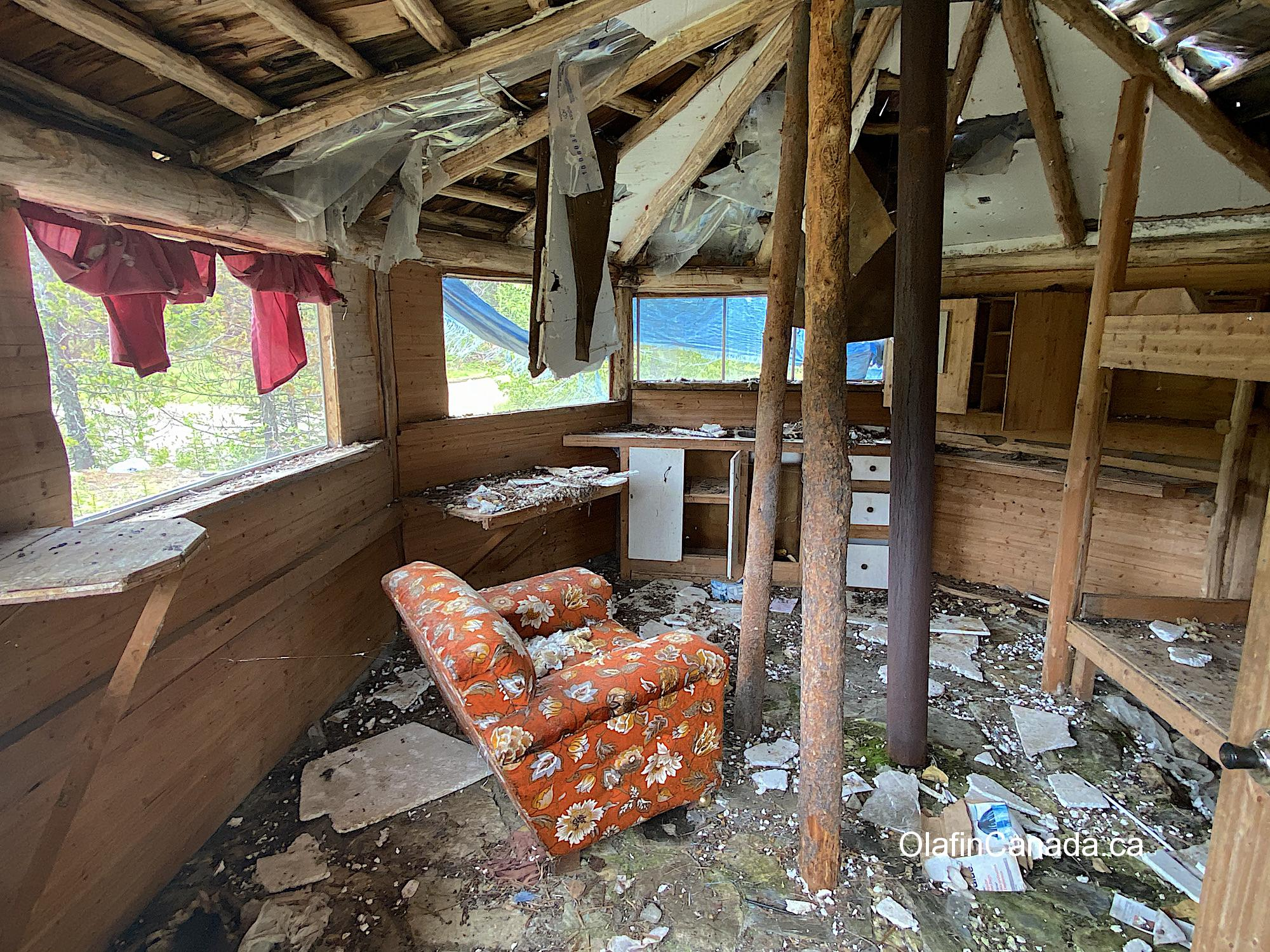 Interior of cabin with old chair at Comet Creek Resort in the Cariboo between Likely and Barkerville #olafincanada #britishcolumbia #discoverbc #abandonedbc #cariboo #cometcreekresort