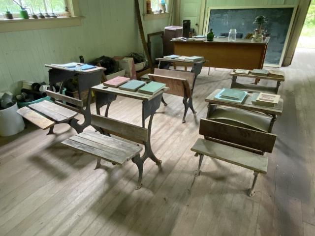 Desks and books inside the school of Alice Arm #olafincanada #britishcolumbia #discoverbc #abandonedbc #alicearm #school