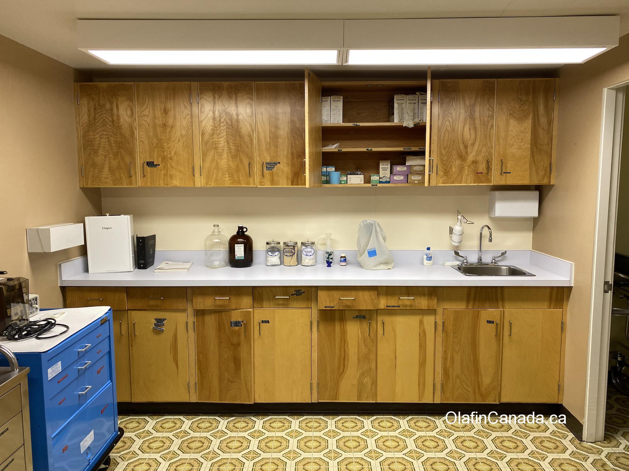 Hospital cabinets filled with medicine, syringes etc. in Kitsault #olafincanada #britishcolumbia #discoverbc #abandonedbc #kitsault #hospital
