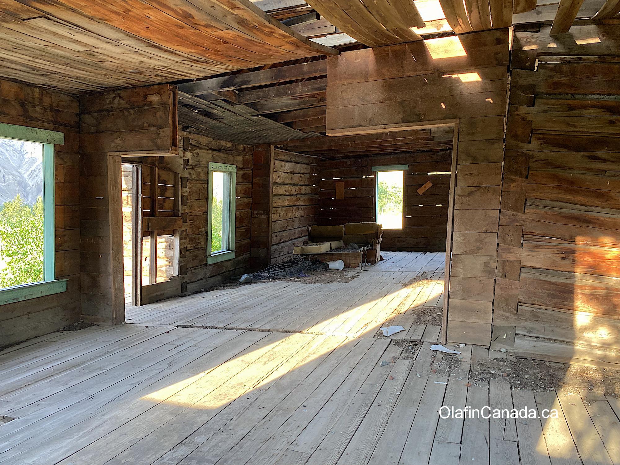 Interior of the log home at the Pothole Ranch with deserted sofa bed #olafincanada #britishcolumbia #discoverbc #abandonedbc #chilcotin #farwellcanyon #potholeranch #homestead