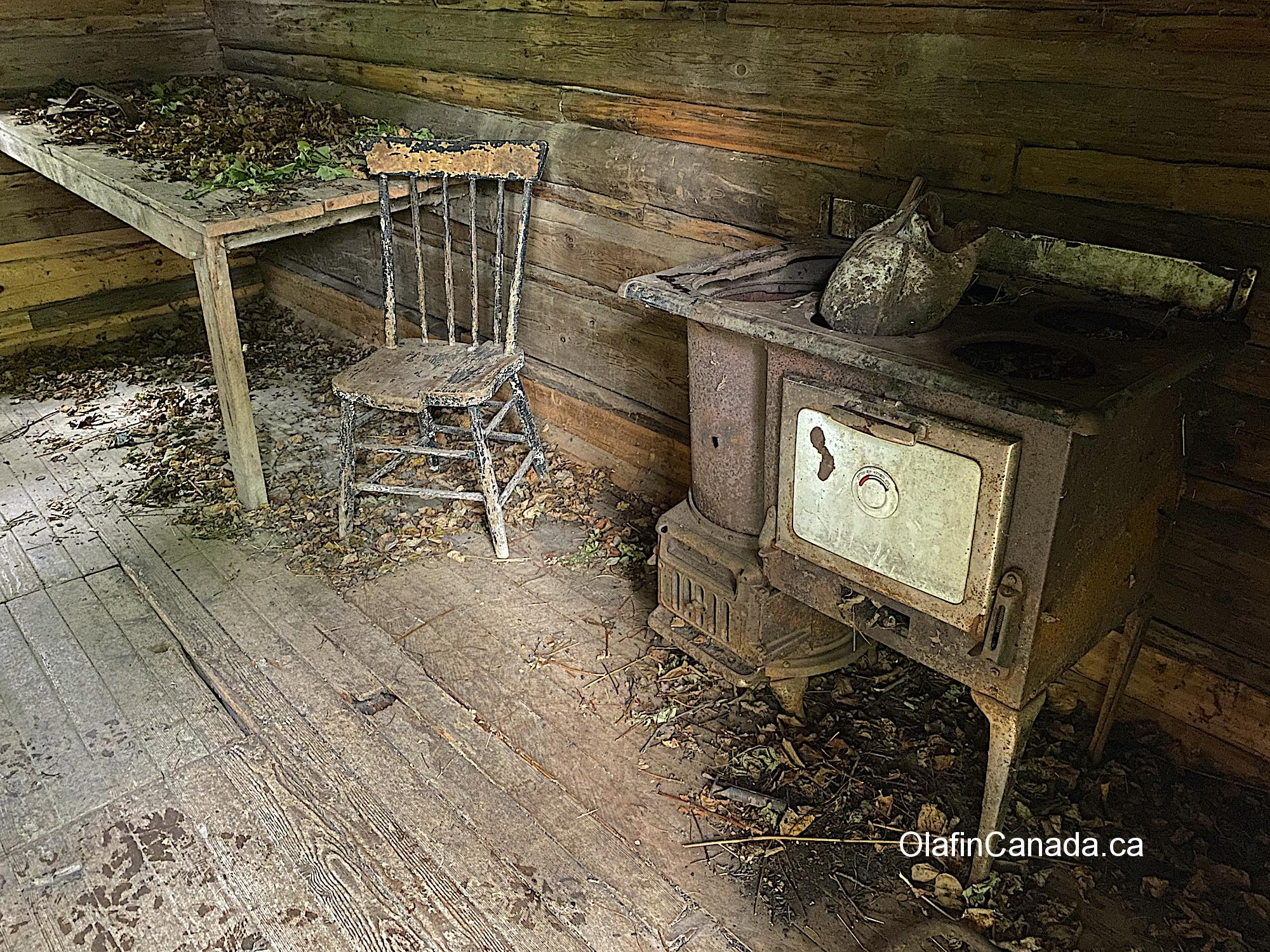 Stove and chair found in a cabin at Quesnel Forks #olafincanada #britishcolumbia #discoverbc #abandonedbc #cariboo #quesnelforks